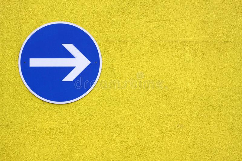Mandatory direction. On a yellow wall royalty free stock images