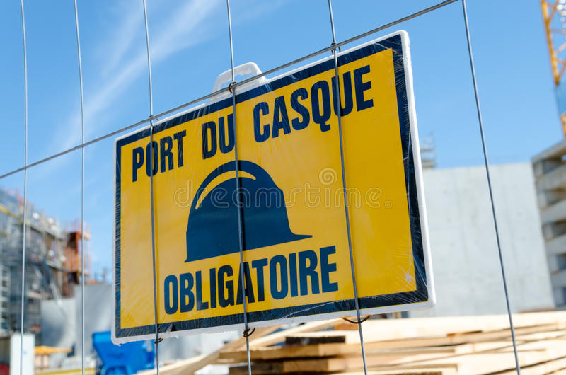 Mandatory helmet sign. On construction site stock photography