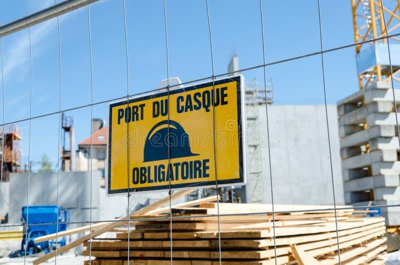 Mandatory helmet sign. On construction site royalty free stock image