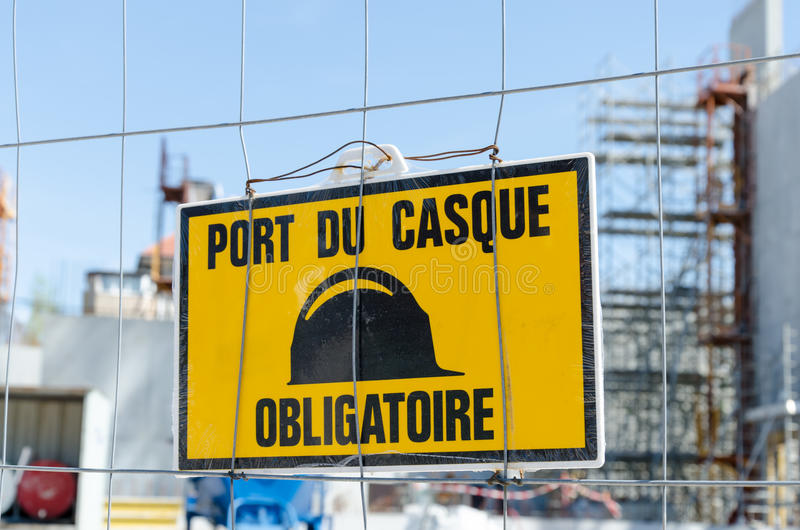 Mandatory helmet sign. On construction site stock images