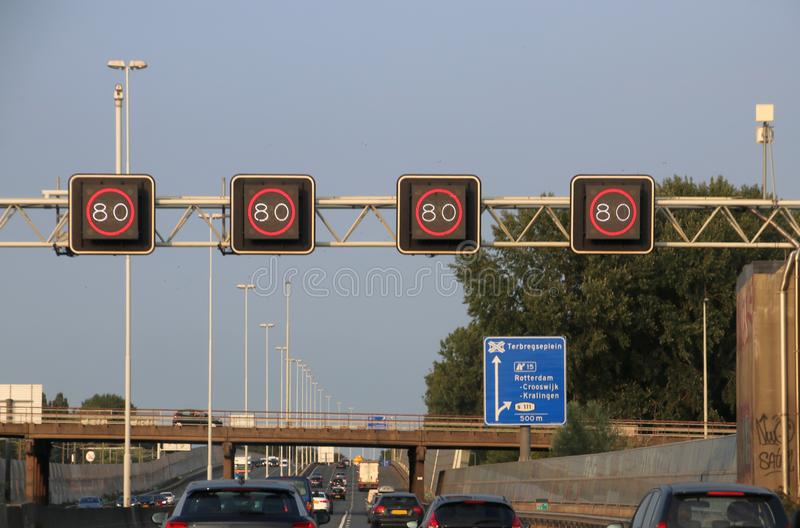 Mandatory speed sign above motorway A20 at Rotterdam, where track controll will measure speed. Mandatory speed sign above motorway A20 at Rotterdam, where track royalty free stock images
