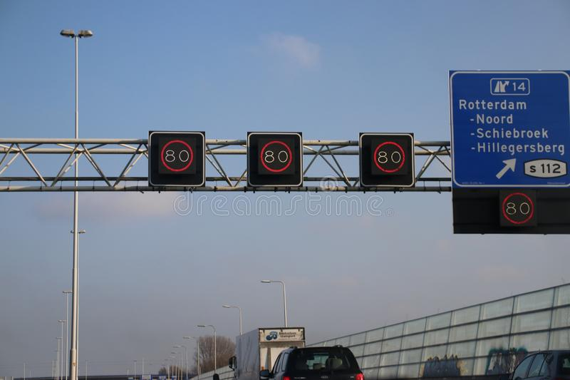 Mandatory speed sign on motorway A20 in Rotterdam. With track control where speed can be dynamic royalty free stock photo