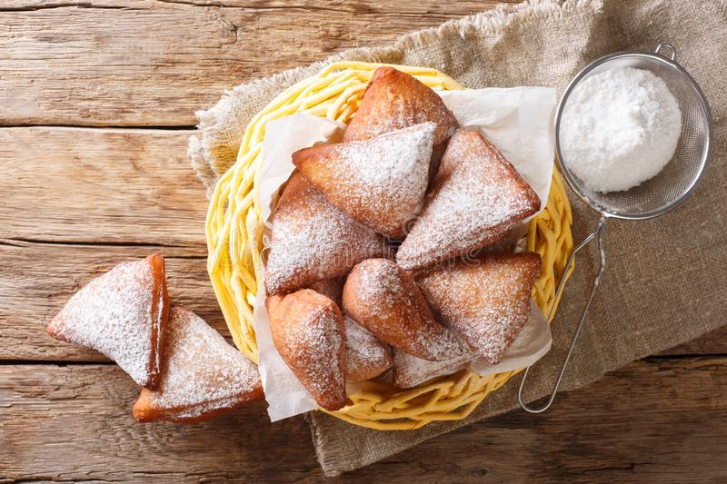 Mandazi, also known as the dabo or South Sudanese Coconut Doughnut close-up in a basket. Horizontal top view stock photo