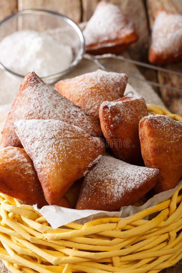 Mandazi, also known as the dabo or South Sudanese Coconut Doughnut close-up in a basket. Vertical stock photos