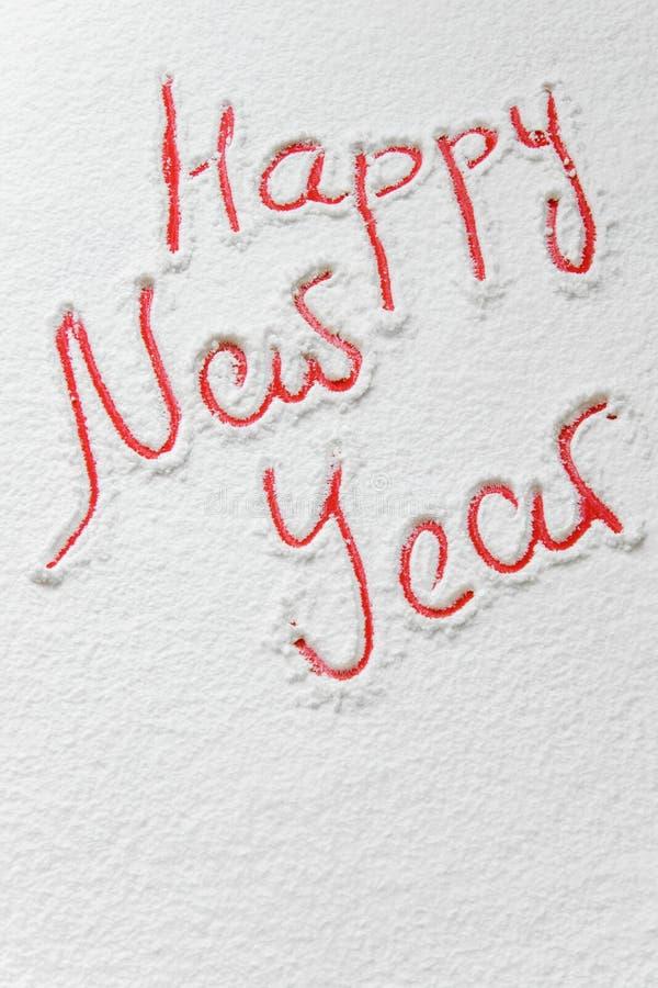 Mande un SMS al ` de la Feliz Año Nuevo del ` en la nieve fotografía de archivo