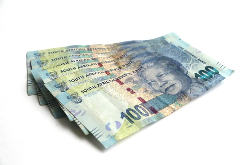 Mandela on a pile of South african hundred rand note. South african hundred rand note money isolated on a white surface with space for text featuring nelson stock photos