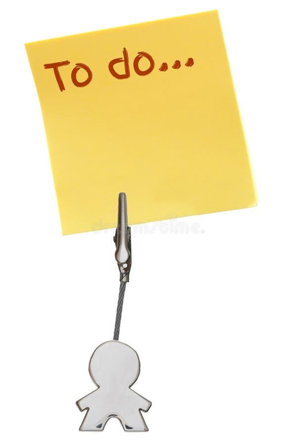 Mandiagram affärskorthållare med gulingpappersanmärkningen som ska göras royaltyfri fotografi