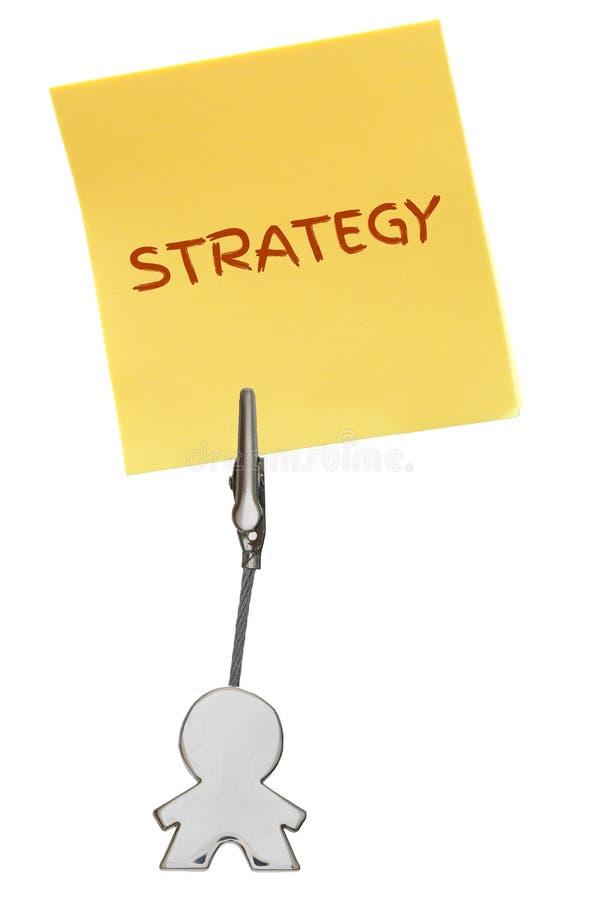 Mandiagram affärskorthållare med STRATEGI för gulingpappersanmärkning royaltyfri foto