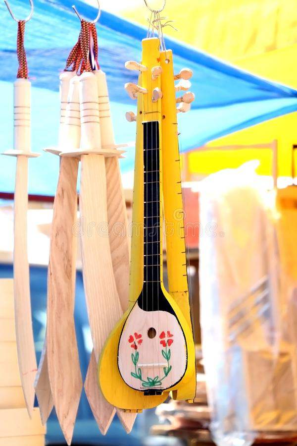 Mandolin. Small traditional wooden mandolin on a flea market. Selective focus stock image