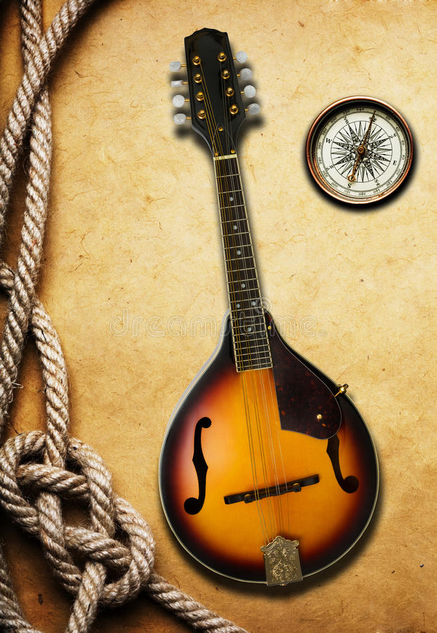 Mandolin. On old paper texture stock photography