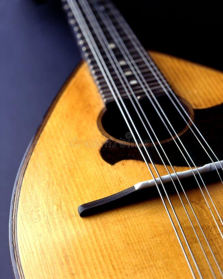 Mandolin. An old mandolin isolated on black background royalty free stock image