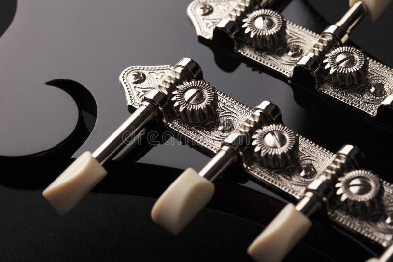 Mandolin detail on black background. Mandolin detail isolated on black background royalty free stock photos