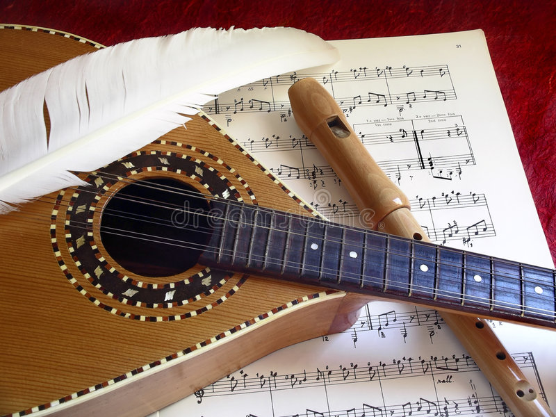 Mandolin and Flute. Wooden Mandolin and flute over music partiture stock photography