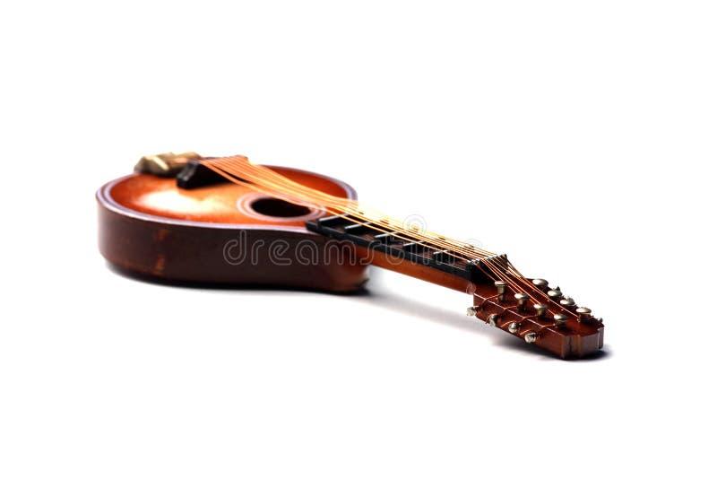 Mandoline op witte dichte omhooggaand als achtergrond stock foto