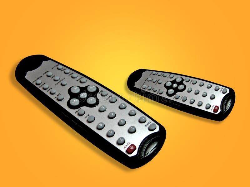 Mandos a distancia de la TV imagen de archivo libre de regalías