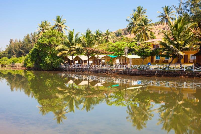 Mandrem beach Goa India. Resort huts on Mandrem beach in north Goa, India royalty free stock photo