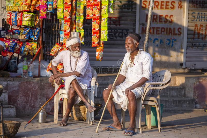Two Indian old men on the street market. Mandu, India royalty free stock photos