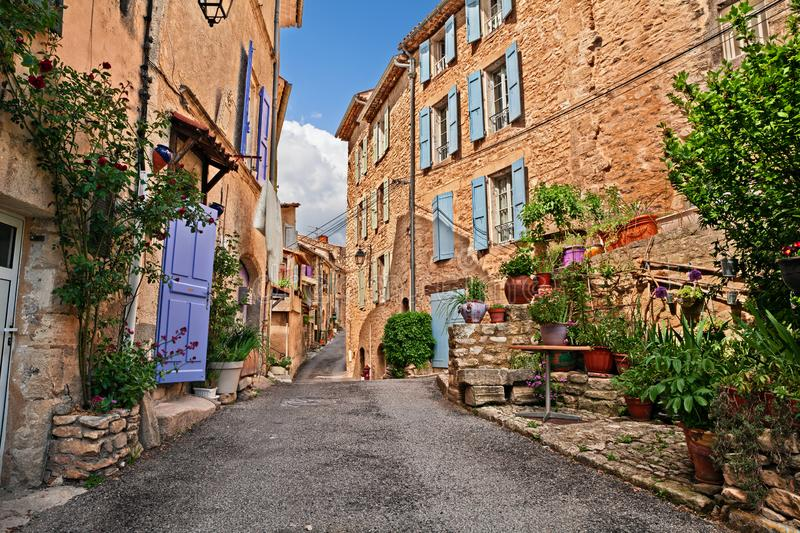 Mane, Forcalquier, Provence, France: ancient alley in the old to. Mane, Forcalquier, Provence, France: picturesque ancient alley in the old town with plants and stock image