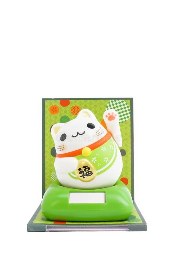 Maneki Neko. A cute Maneki Neko or a Japanese welcoming cat isolated on white background royalty free stock photography