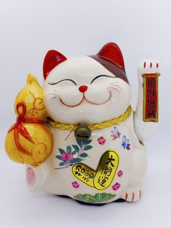 Maneki-neko jest imieniem szczęsliwy kot, Symbolizować szczęsliwy i zamożny obrazy royalty free