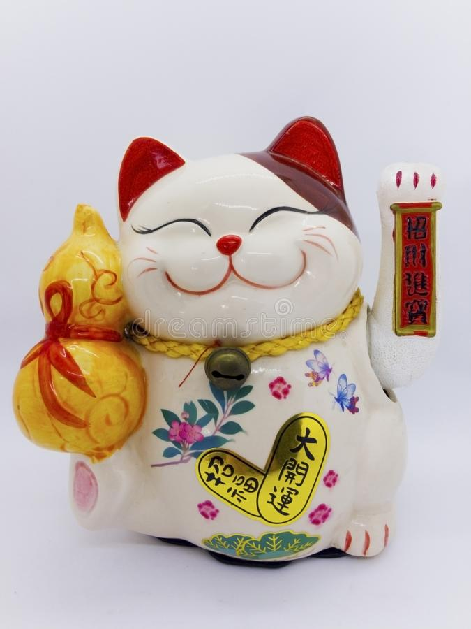 Maneki-neko is name of lucky cat, Symbolizing lucky and wealthy. royalty free stock images