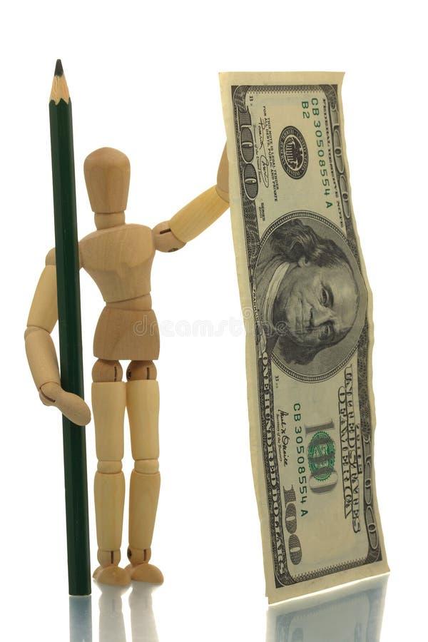 Manequim com lápis e dinheiro imagem de stock royalty free