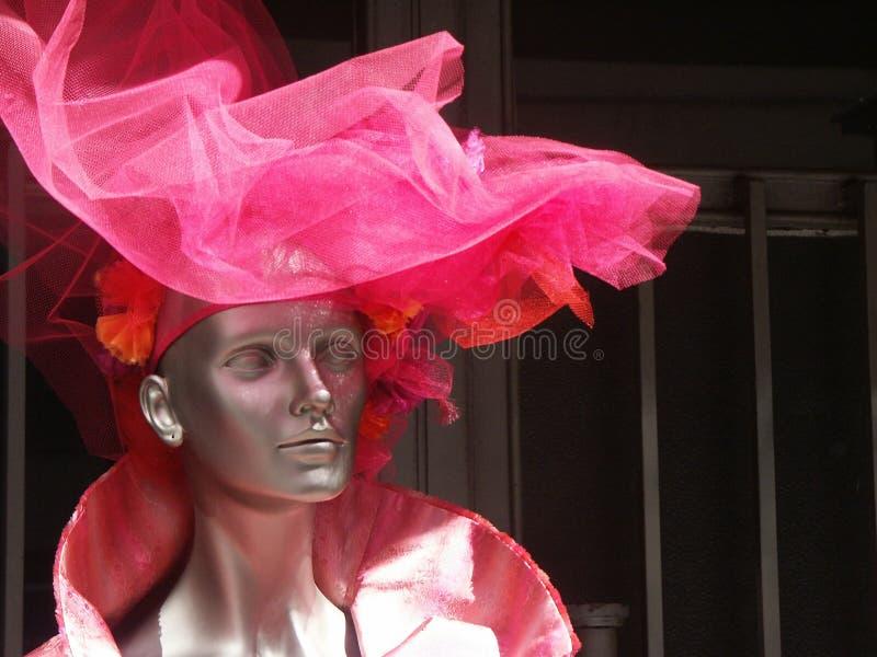 MANEQUINE met rode hoed stock foto