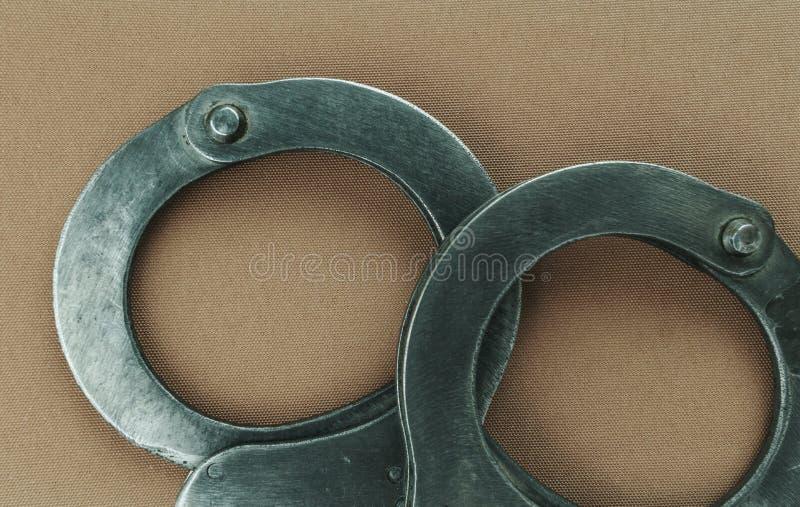 Manette d'acciaio dell'attrezzatura speciale della polizia, fetters fotografie stock