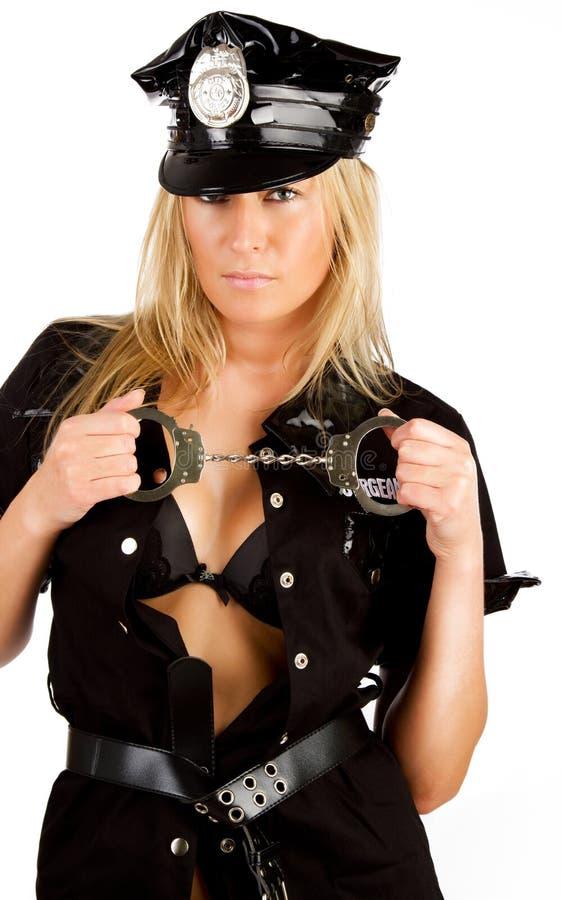 Manette sexy del wih della poliziotta fotografia stock
