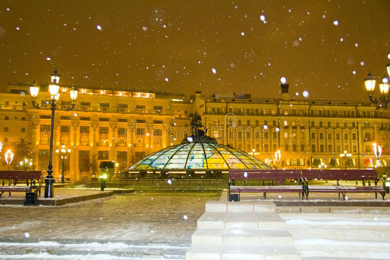 Manezhnaya square in the evening on a snowy winter in the light of lanterns stock image