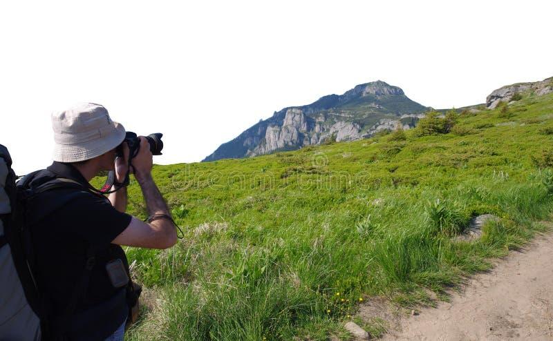 Manfotograf som tar foto på berget arkivfoto