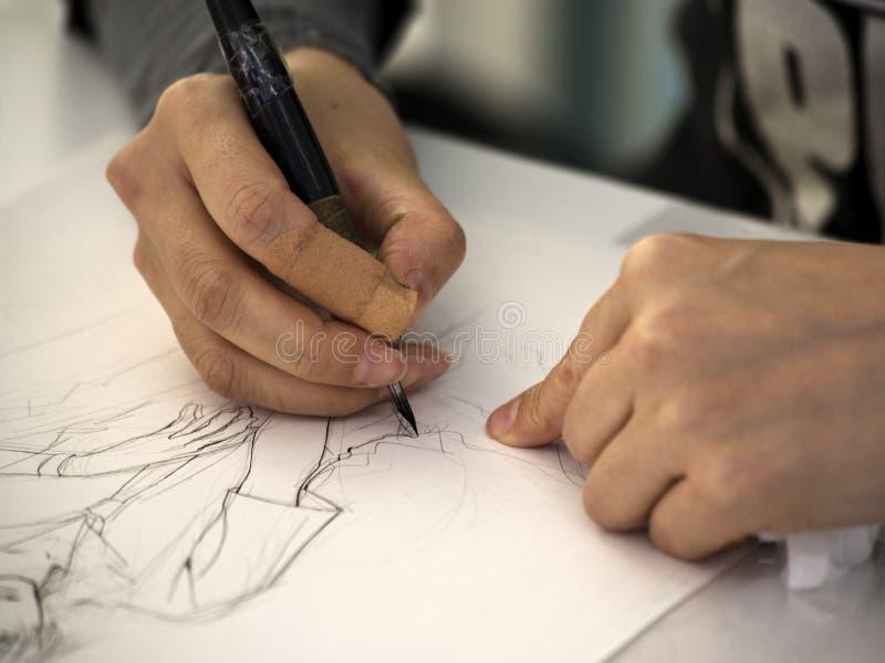 Manga artist drawing royalty free stock image