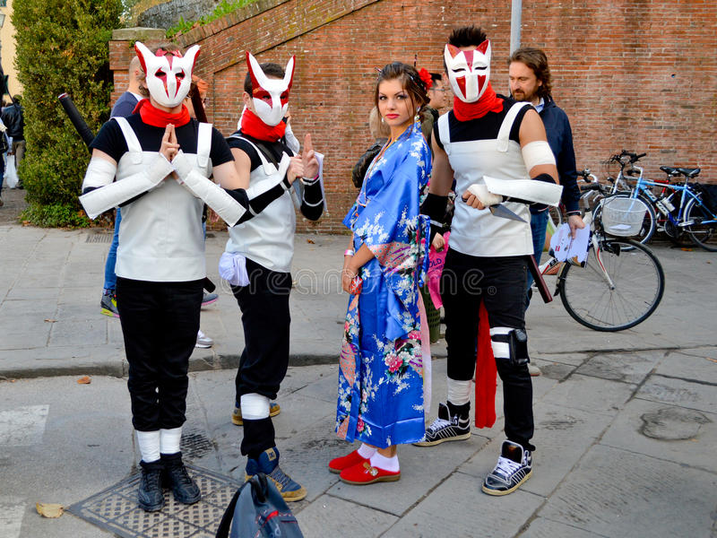 Manga cosplayers at Lucca Comics and Games 2014. A group of cosplayers during the Lucca Comics and Games 2014 festival. Lucca Comics & Games is an annual comic royalty free stock photo