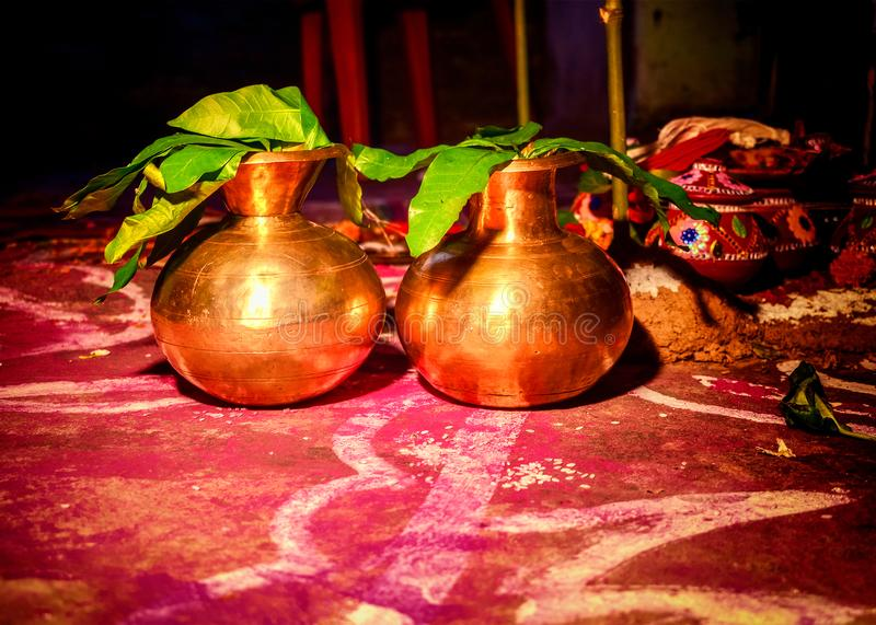 Mangalghat, the holy water kept into metallic pots for Hindu Indian wedding ceremony tradition stock photo