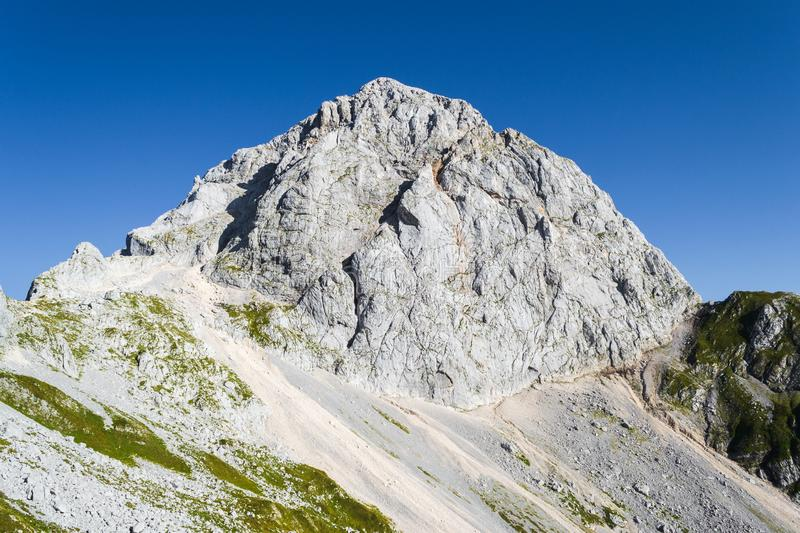Mangart or Mangrt peak, a mountain in the Julian Alps, located on the border between Italy and Slovenia, at 2,679 metres high. Mangart or Mangrt peak, a royalty free stock photo