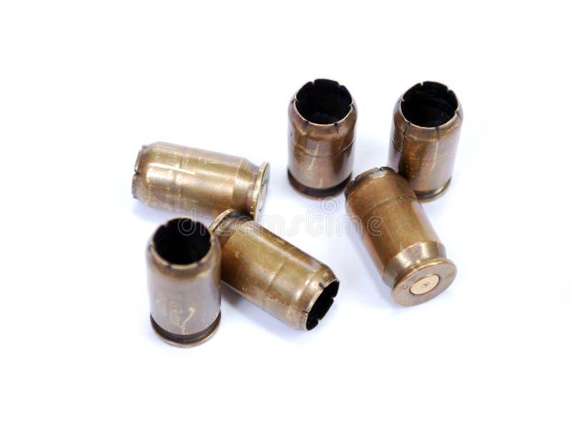 Mangas de cobre amarillo tiradas de un arma traumático del caucho del calibre 45 foto de archivo libre de regalías