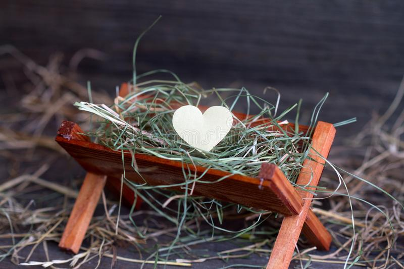 Manger Jesus and the heart of love abstract christmas symbol. Closeup royalty free stock images