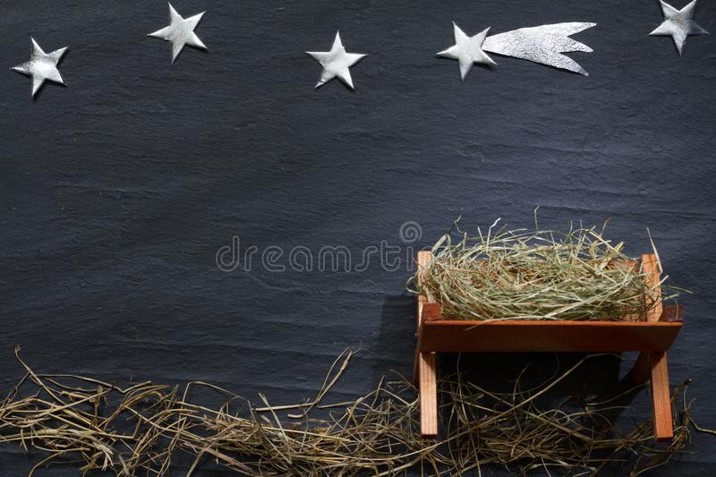 Manger and star of Bethlehem abstracy christmas background nativity scene on black marble. Closeup royalty free stock images