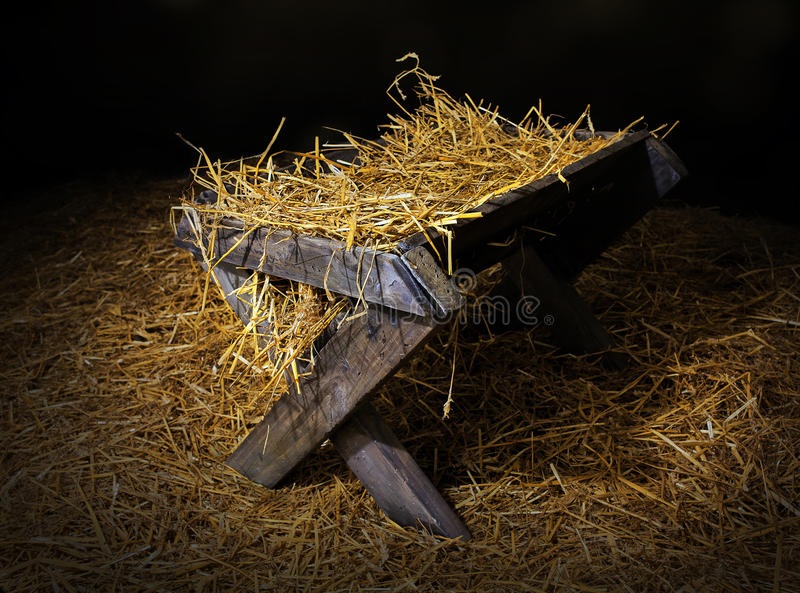 Manger with straw. An old manger filled with straw stock image