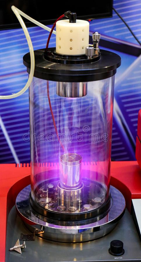 Free Mangetron Sputtering With Purple Glowing Plasma In Vacuum Glass Tube Stock Images - 168448204
