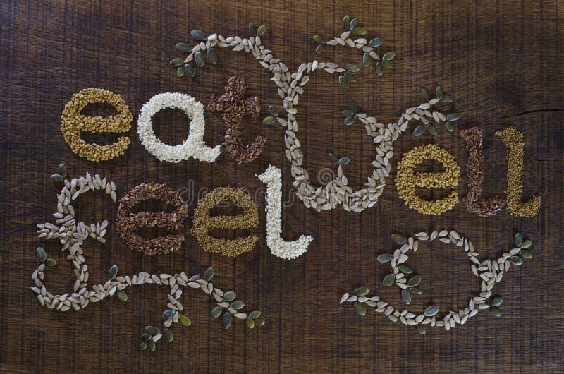 Mangi bene, Be bene è scritto e decorato in semi immagine stock