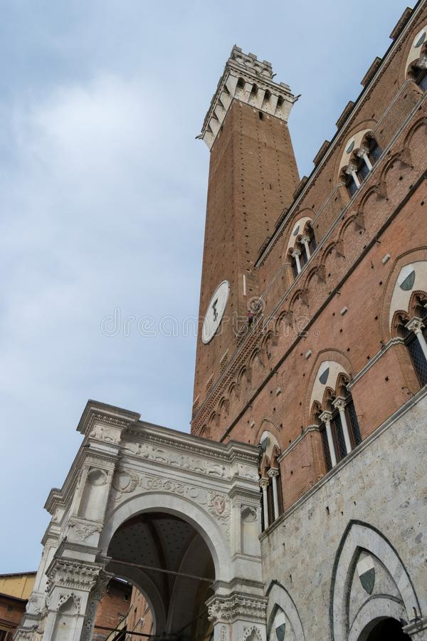 Mangia Tower or Torre del Mangia on Piazza del Campo in medieval. City of Siena in Tuscany, Italy stock photography