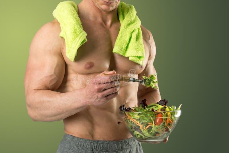 Mangiatore di uomini sano un'insalata fotografia stock libera da diritti