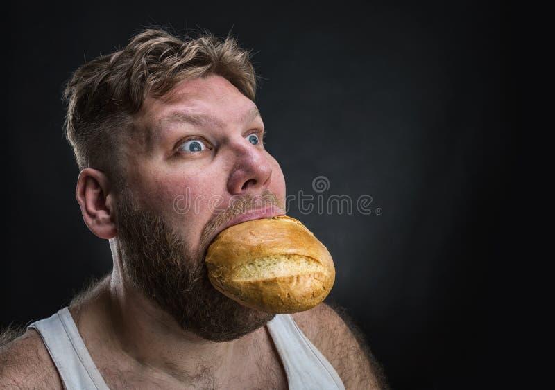 Mangiatore di uomini un grande pane immagini stock
