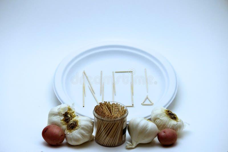 Mangiatore difficile - aglio e patata fotografia stock