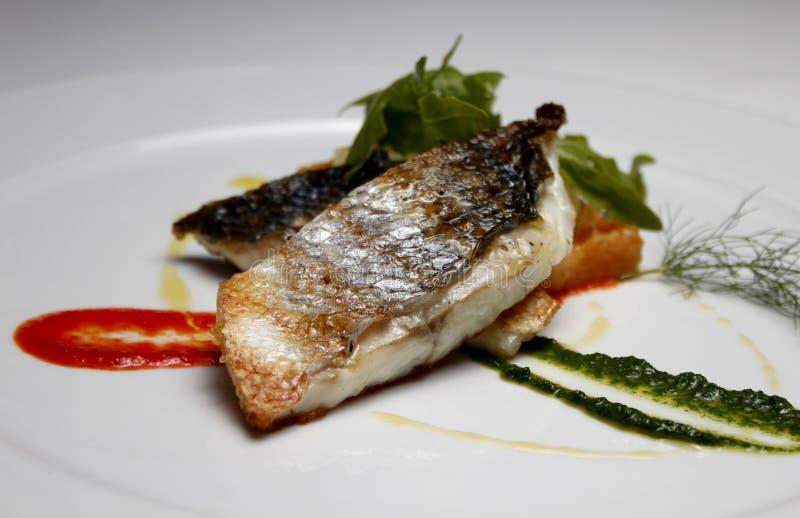 Mangime per pesci fotografie stock