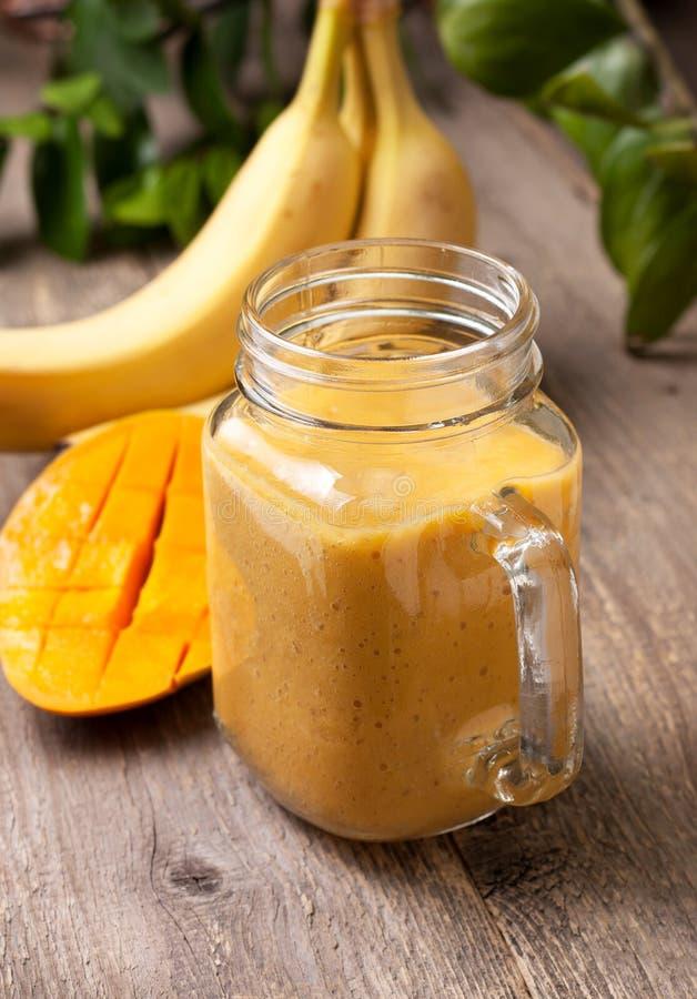 Mango banana smoothie royalty free stock image