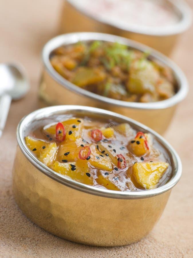 Mango Chutney with Lime Pickle and Raita.  royalty free stock photo