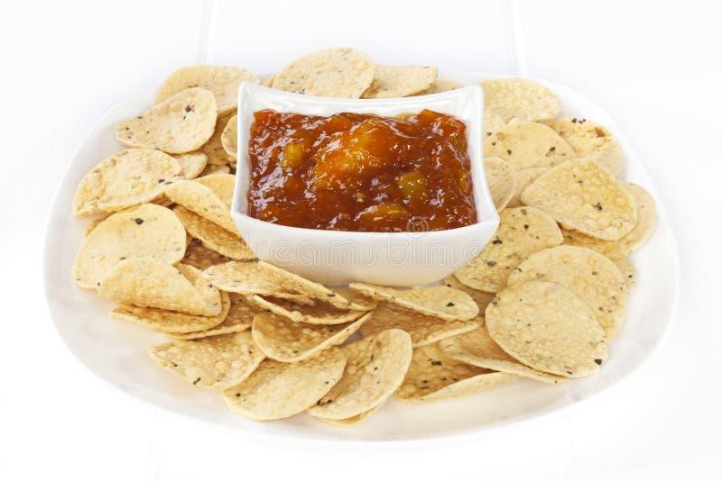 Mango Chutney and Mini Poppadums stock images