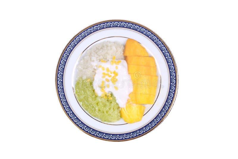 Mango dorato maturo con verde e bianco di riso appiccicoso fotografia stock